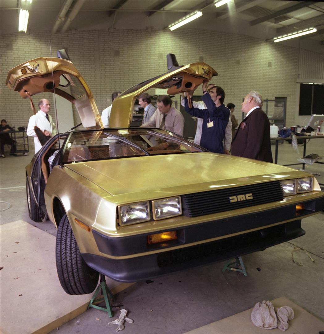 Gold car assembly with Dick Kendall (far right) | DeLoreanDirectory.com
