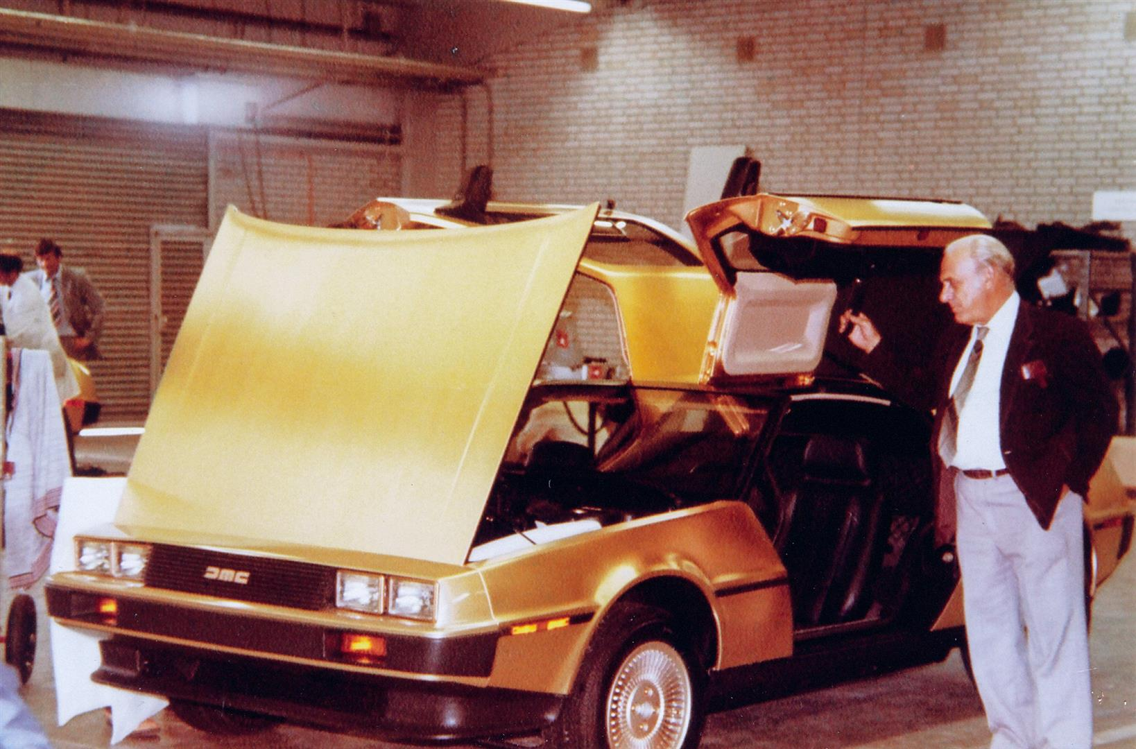 Gold car assembly in the EVP crib, with assembly team leader Dick Kendall looking on | DeLoreanDirectory.com